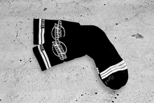 Load image into Gallery viewer, Sideways Socks by DYEDBRO laid out on the floor