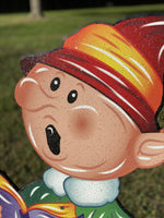close up of singing elf head painted yard art design