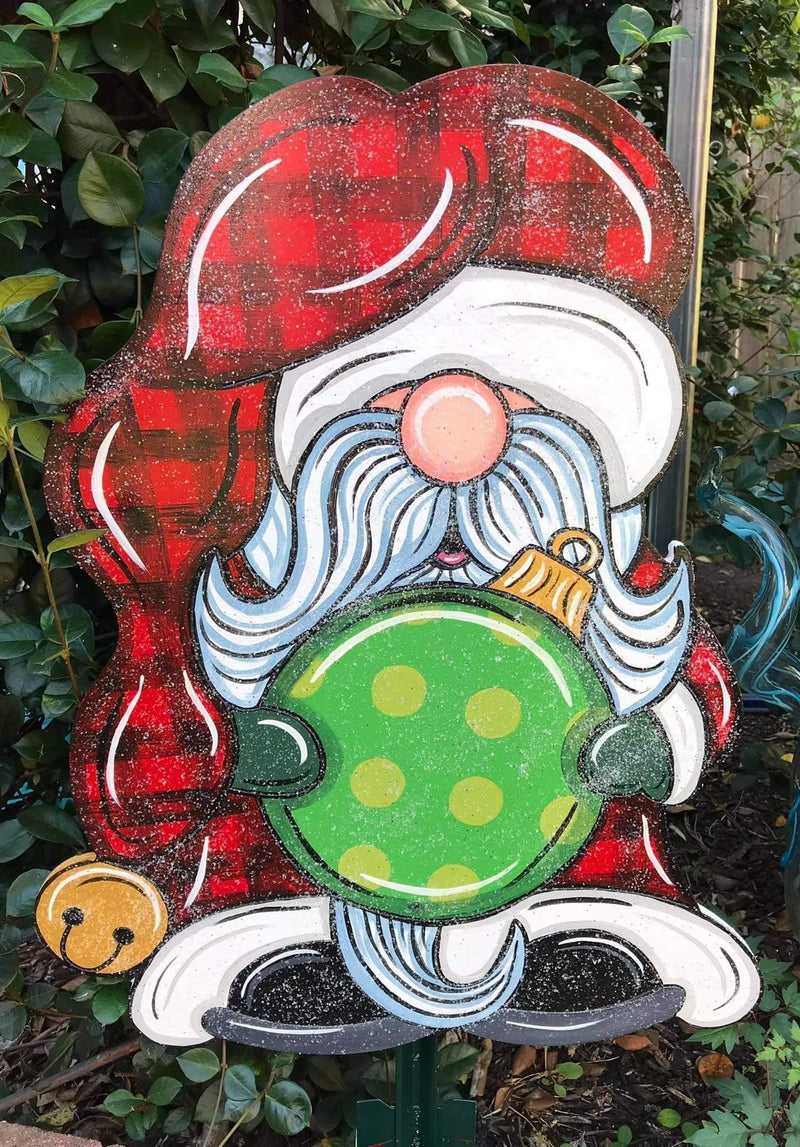 glitter santa gnome holding ornement with checkard santa hat painted yard art design