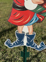 close up of elf shoes painted yard art design