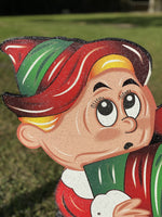 close up of elf with present's head painted yard art design