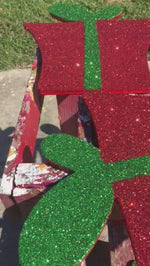 video of painted glitter presents drying
