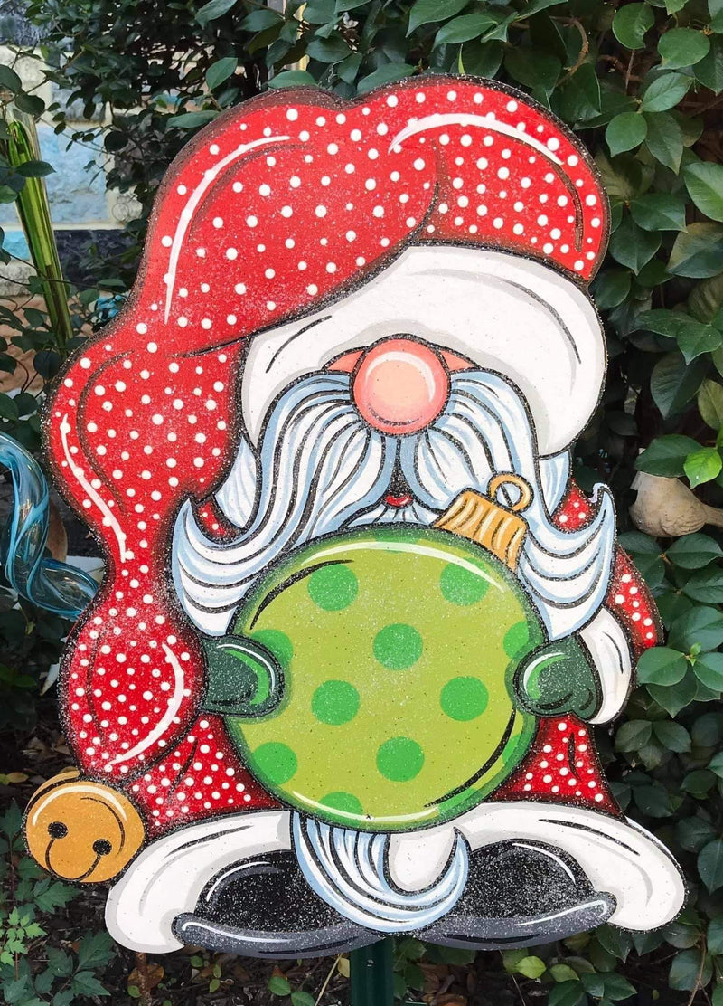 glitter santa gnome holding ornement with polka dot santa hat painted yard art design