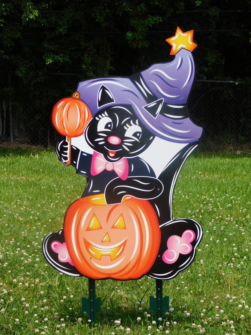 black cat with purple hat and jack-o-lantern painted yard art design