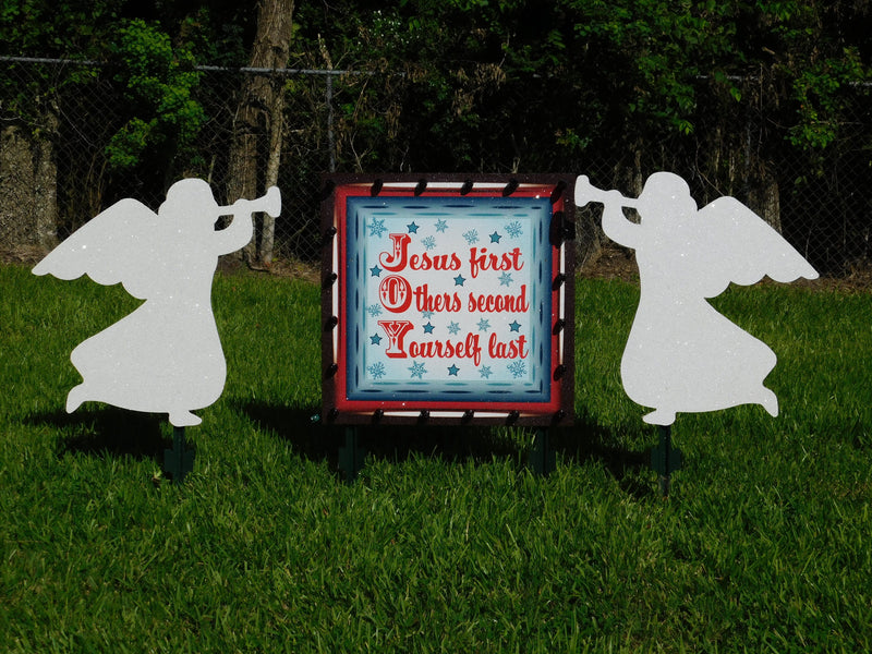 JOY-Jesus first lighted sign with two angels playing trumpets