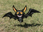 cute smiling bat with extended wings painted yard art design