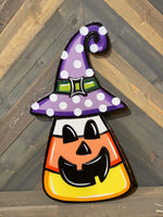 candy corn with witch's hat and face painted yard art design