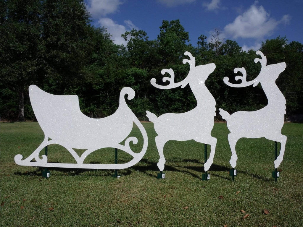 white litter sled and 2 reindeer painted yard art design