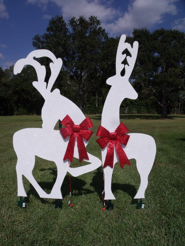 white glitter reindeer silhouette with red glitter light up bows painted yard art design