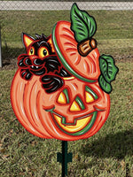 cat coming out of pumpkin painted yard art design
