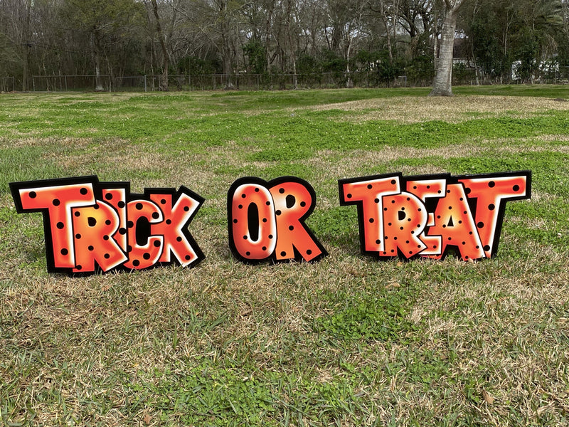 trick or treat orange with black dots letters painted yard art design
