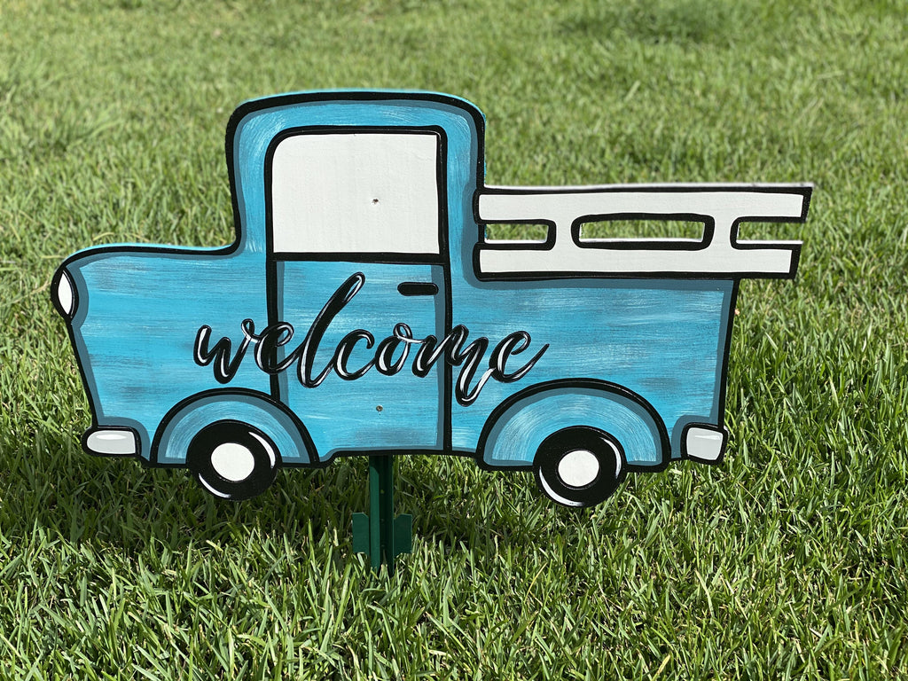 light blue hand painted truck yard art