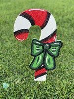 left facing Christmas Candy cane with bow painted yard art design