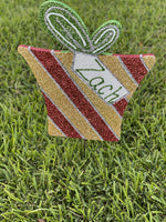 striped glitter Christmas present with tag painted yard art design