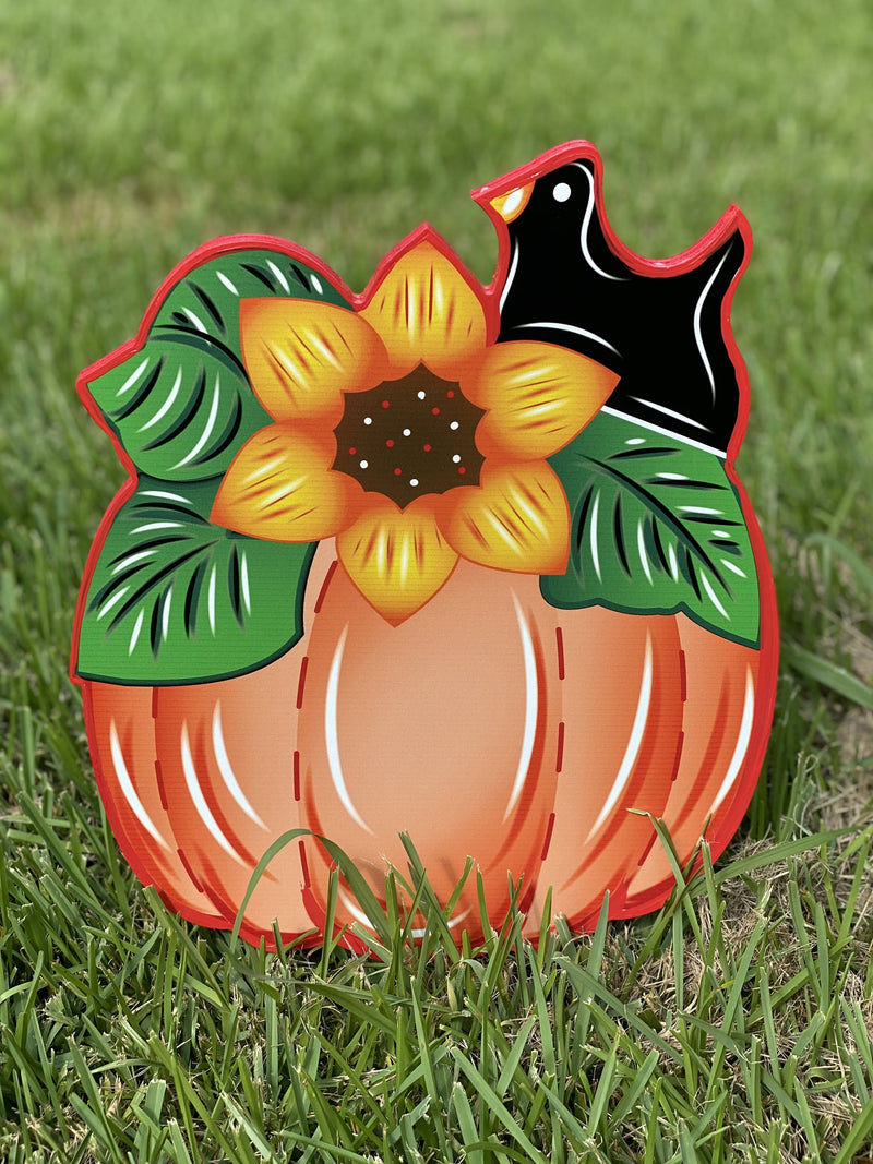 small pimkin with sunflower stem and crow painted yard art design