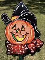 pumpkin with cowboy hat and bandana painted yard art design