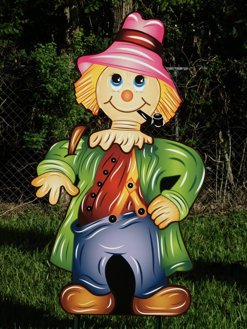scarecrow with pipe and pink hat painted yard art design