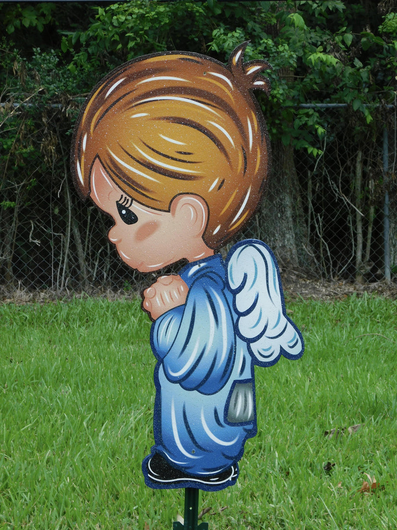 male child angel with blue garnments facing left painted design