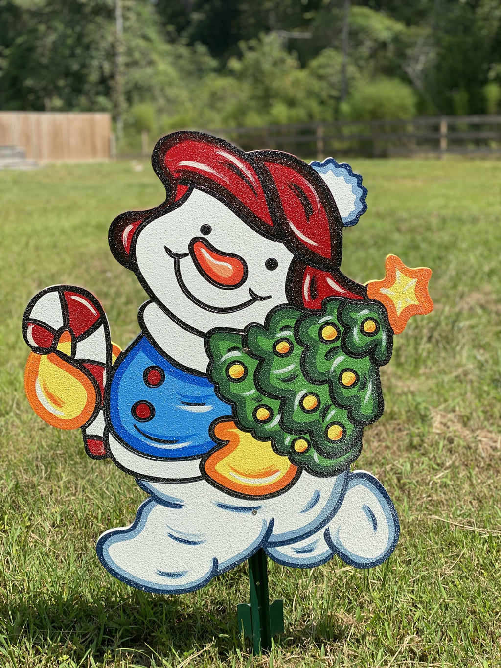 baby snowman holding christmas tree painted yard art design