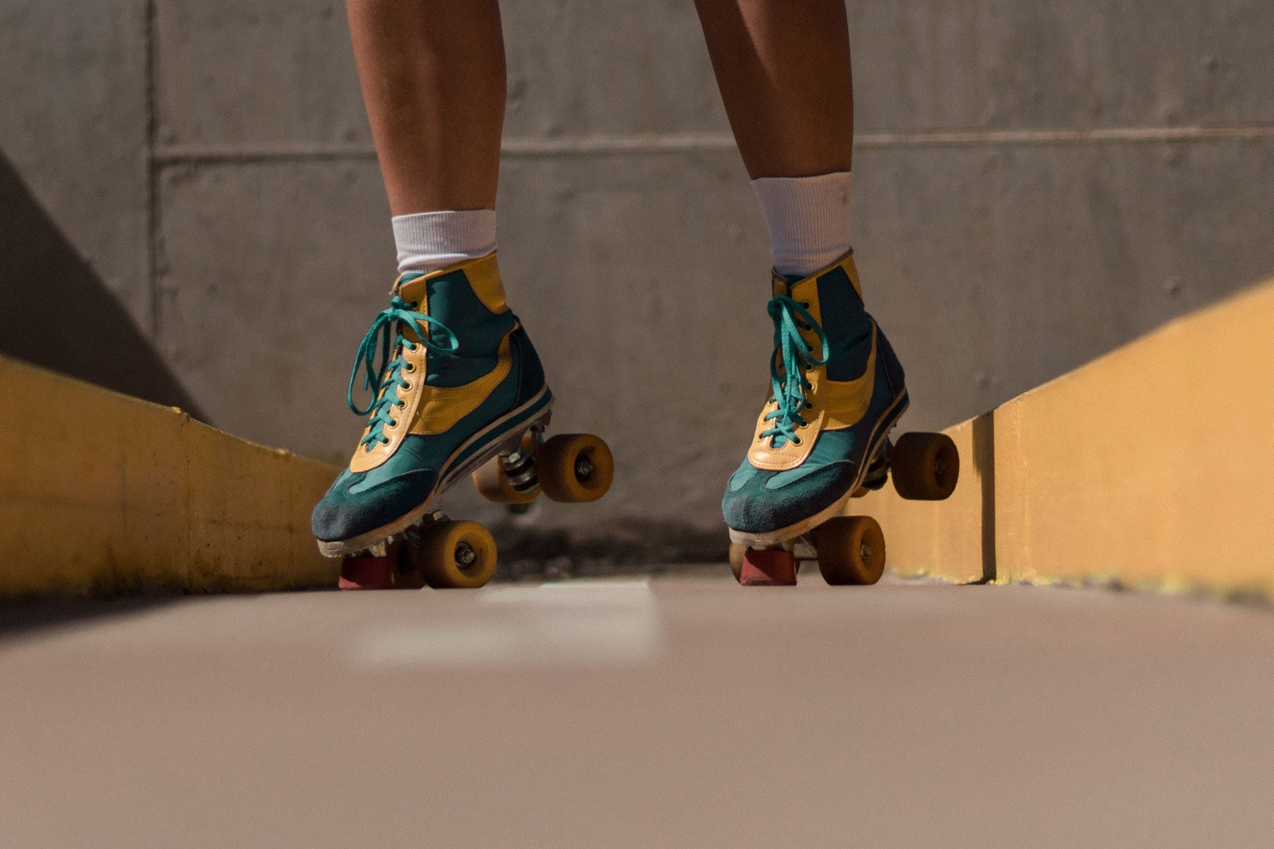 person jumping in roller skates