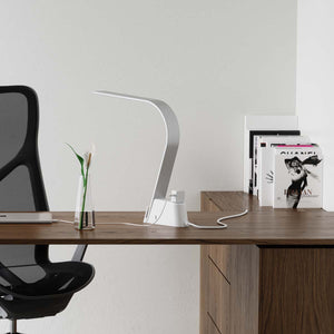 The LUX Brooklyn AC LED Task Lamp has built-in universal AC outlets for charging computers and any device requiring a source of electricity.