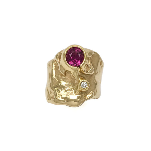 The Caldera ring set with a red pink sapphire