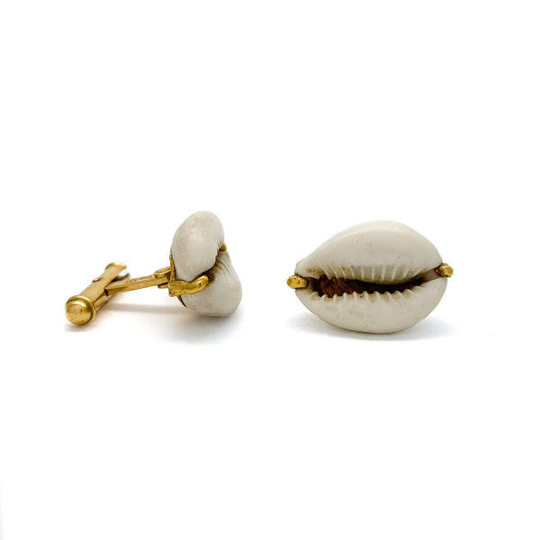 Cowry shell cuff links, an ancient form of money