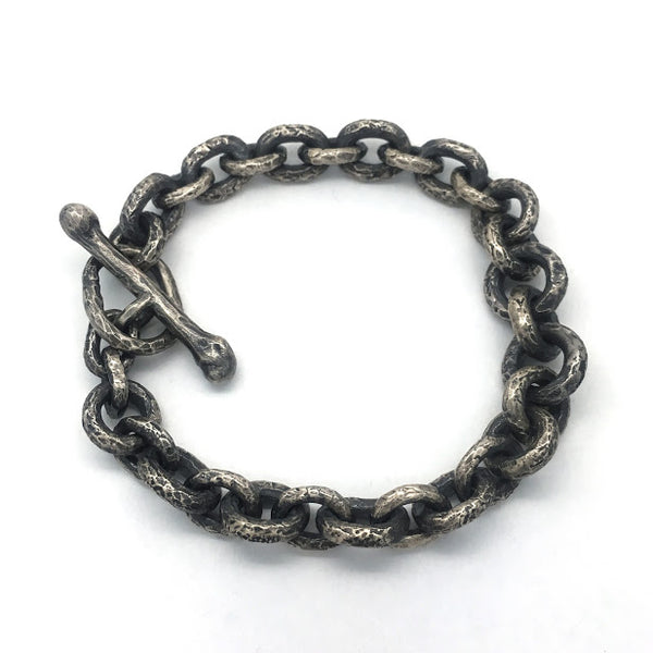 Bracelet composed of heavily textured round and oval links
