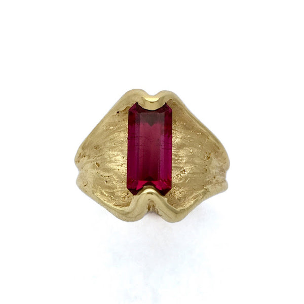 Inside out ring set with an emerald cut rubellite tourmaline