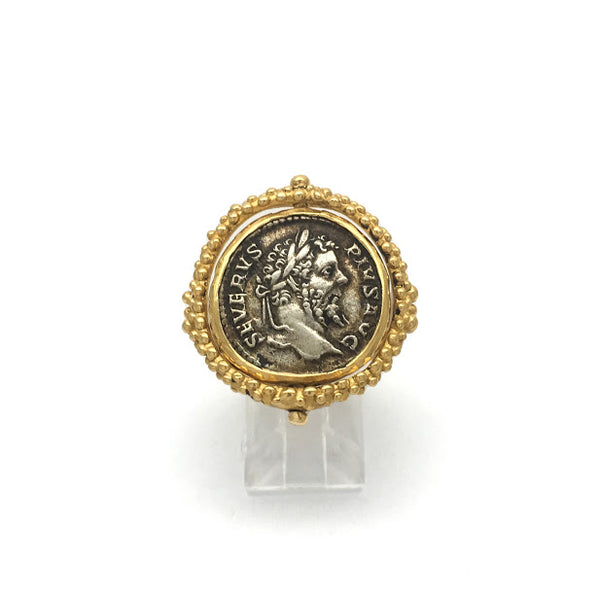 Caste granulation stirrup ring featuring an ancient Dentrius, Septimius Severus coin from 206 CE