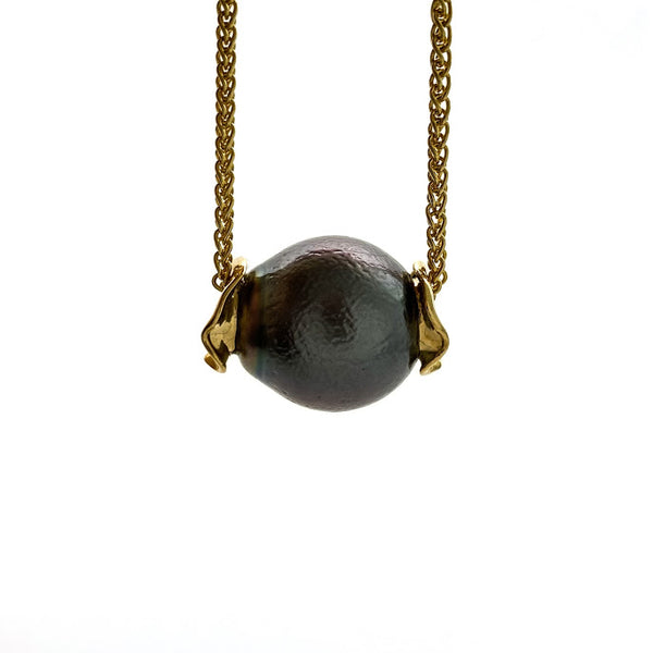 Baroque black Tahitian pearl with an orange peal texture