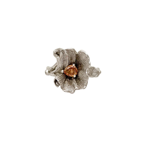 Blossom with a string of leaves around the band set with fancy brown orange diamond