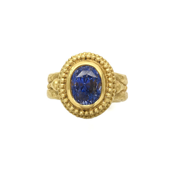 Caste granulation band set with blue sapphire