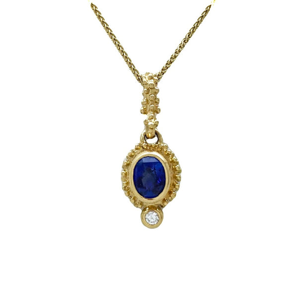 Sapphire and diamond set in caste granulation