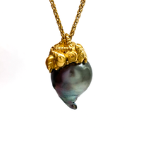 Baroque rainbow Tahitian pear with a micro sea shell cap