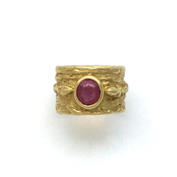 Bark texture ring with twigs and buds bezel set with a ruby cabochon