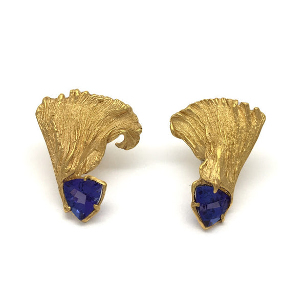 Mismatched feathered earrings set with trillion Tanzanites