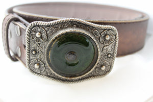 Handmade belt buckle made from a recycled wine bottle