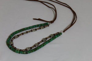 Double stand necklace with green turquoise and pearls on brown suede