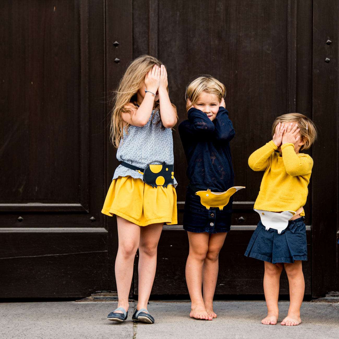 Children wearing Eperfa leather belt bags