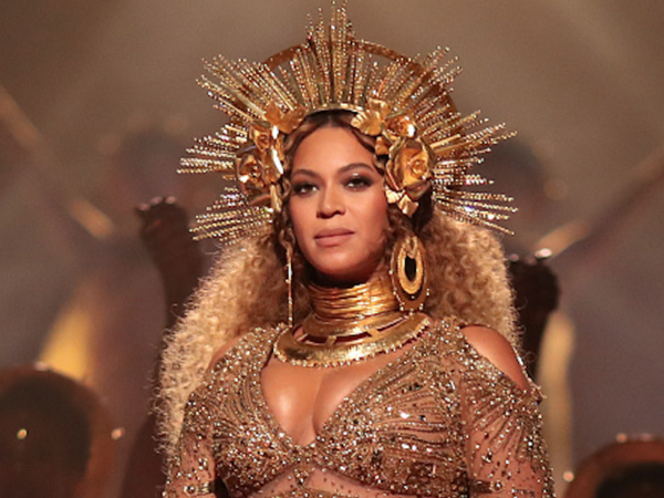 Beyoncé's Grammy dress had her face on it and we can't believe we missed it