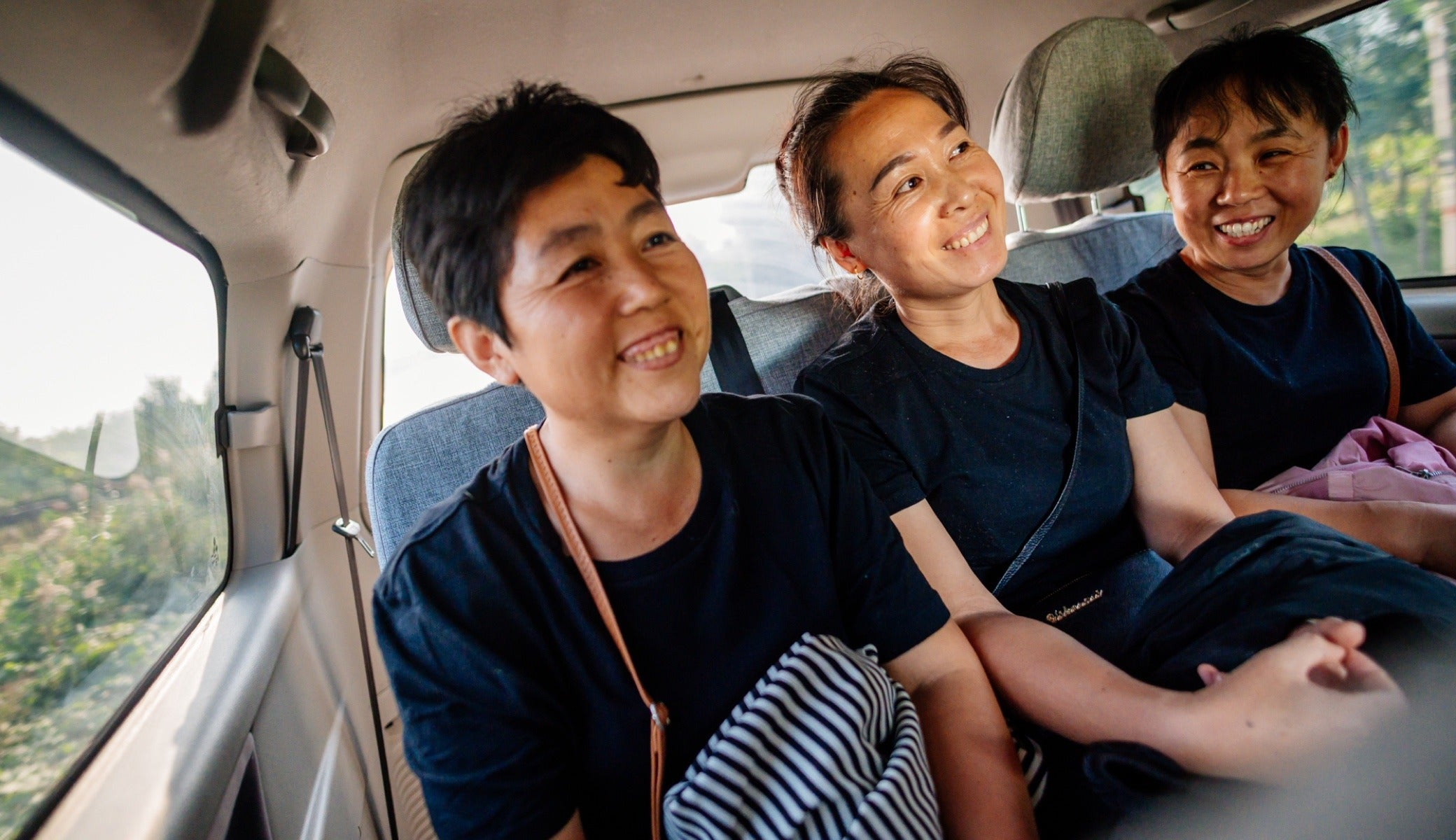 Employees get a ride home in a van as part of the ride share program initiated by owner George Huang. The program provides safe transportation and an opportunity to earn more income for the drivers