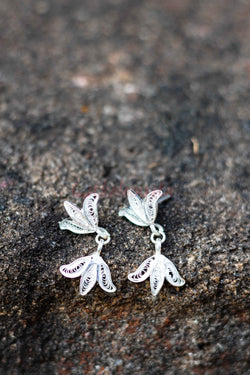 Lotus Hanging from Lotus Tops