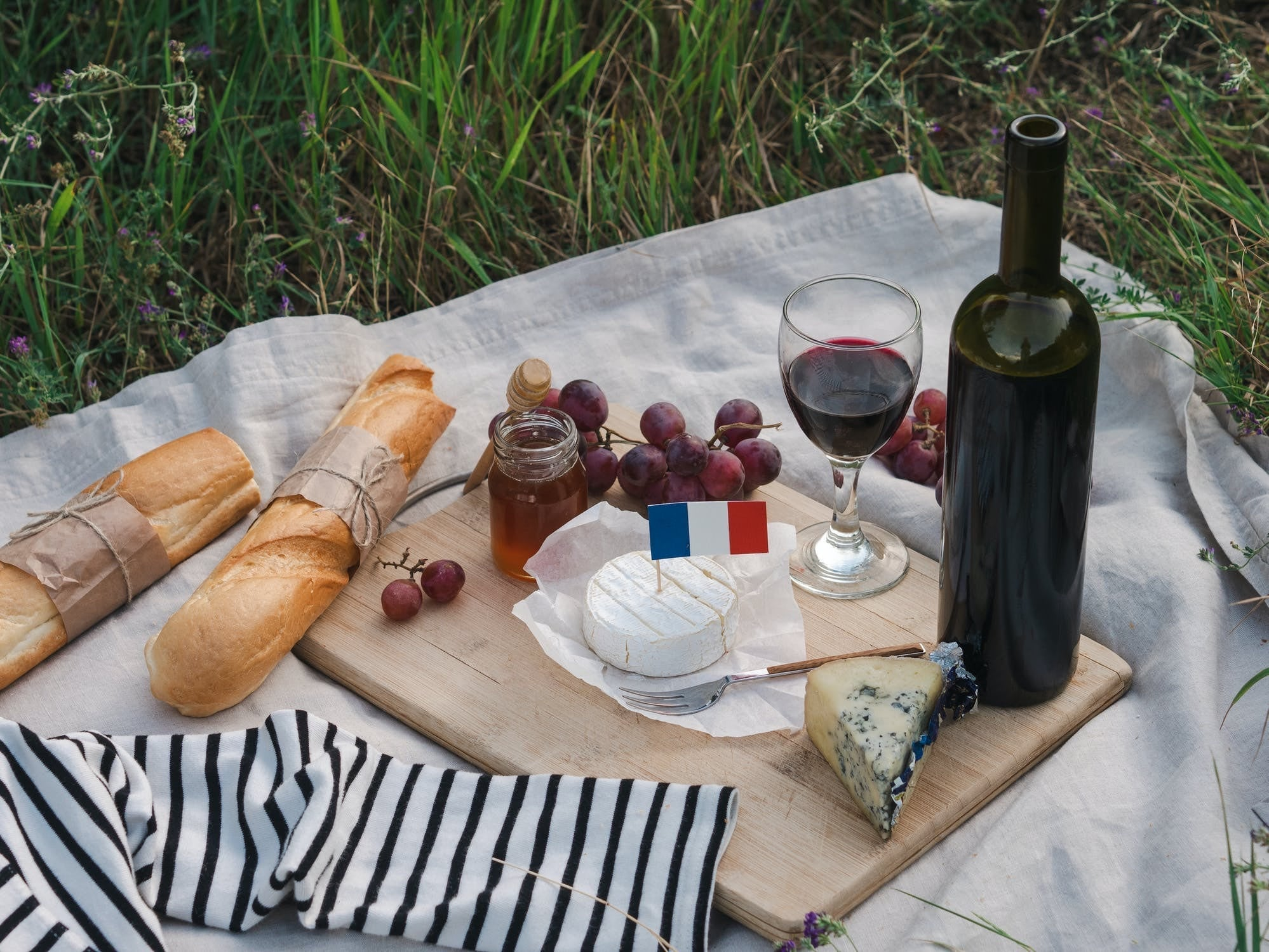 French picnic with wine, cheese, and fresh bread.