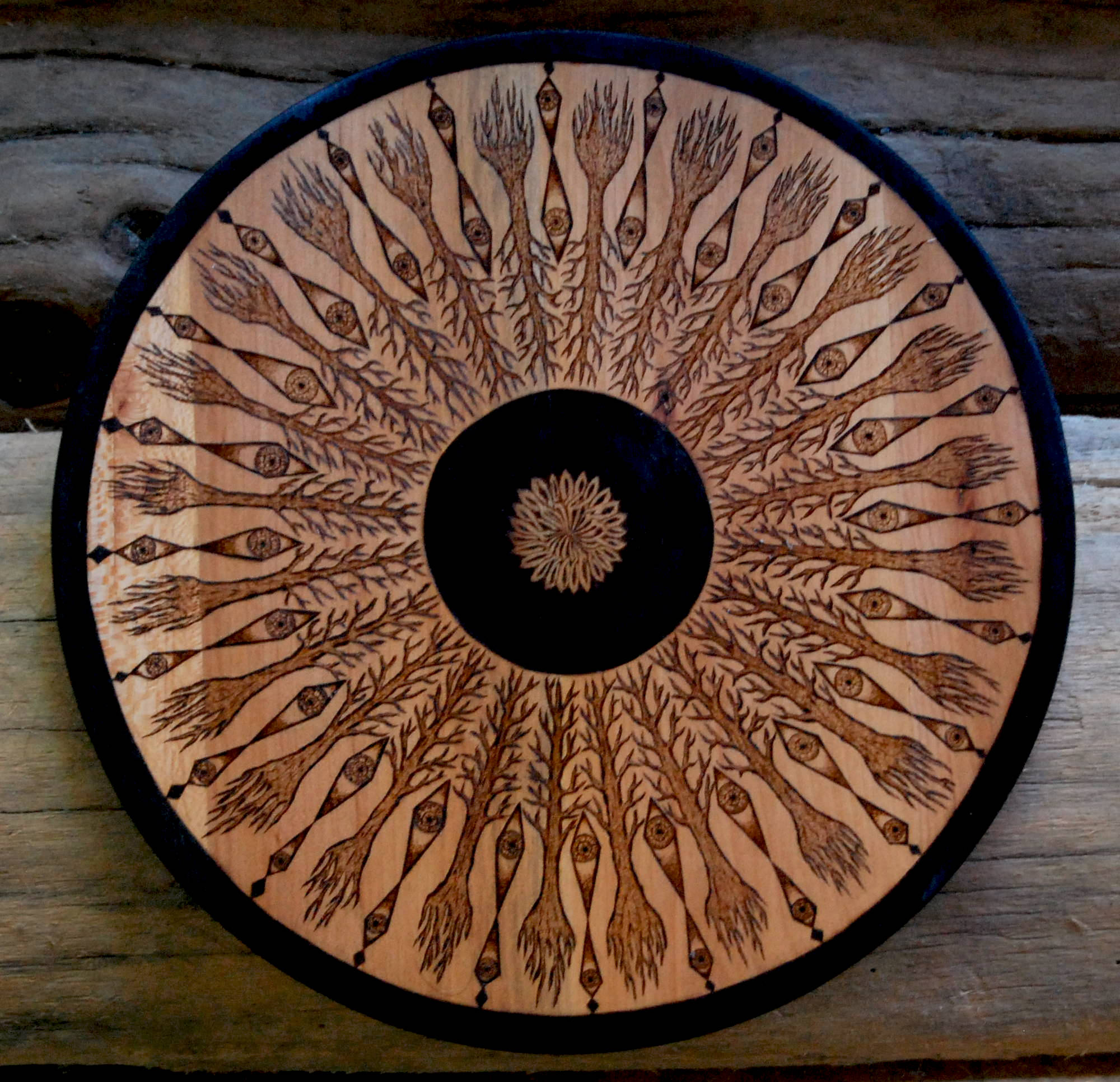 Mandala Pattern with Trees and Eyes Woodburning on Recycled Wood.