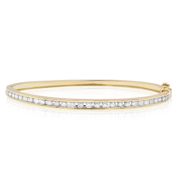 Thin Yellow Gold Bangle With Channel Set Diamonds