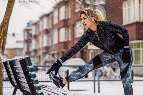 Woman stretching in winter.