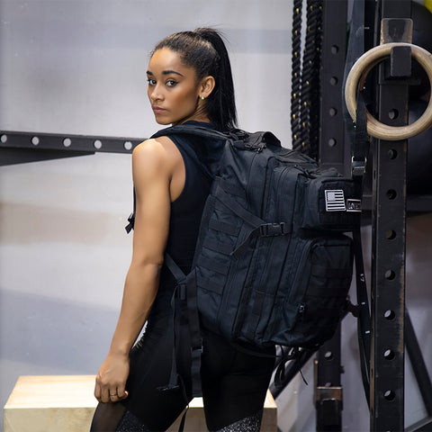 Lena wearing 55L Grizzly Tactical Backpack Black