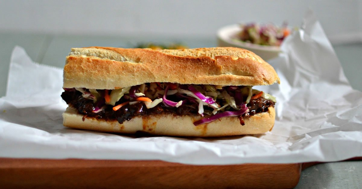 Pulled Beef Baguette & Choice of Side - $15/6inch Sub