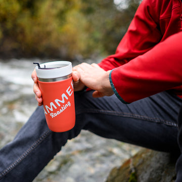 Drinking coffee by the river.